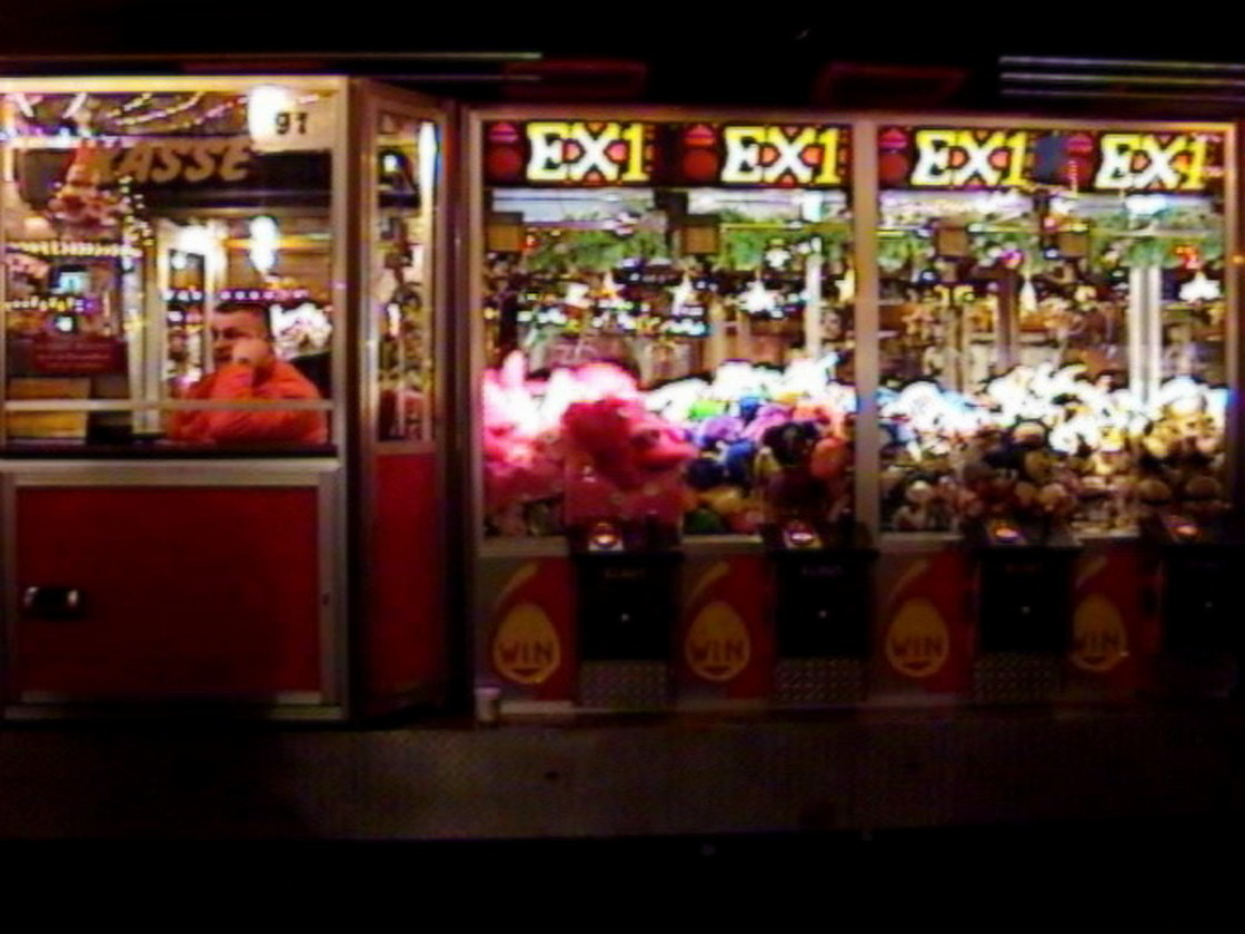 before the space of a square: still from SWEETS AT THE FAIR 2007/10, a paradig-matic film