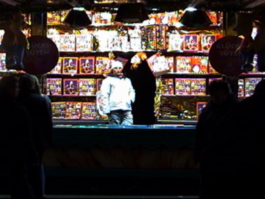 before the space of a square: still from SWEETS AT THE FAIR 2007/2010, a paradig-matic film